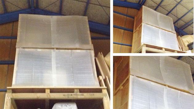 工場内の粉塵で製品が汚れないようにネツケーでロールカーテンのように